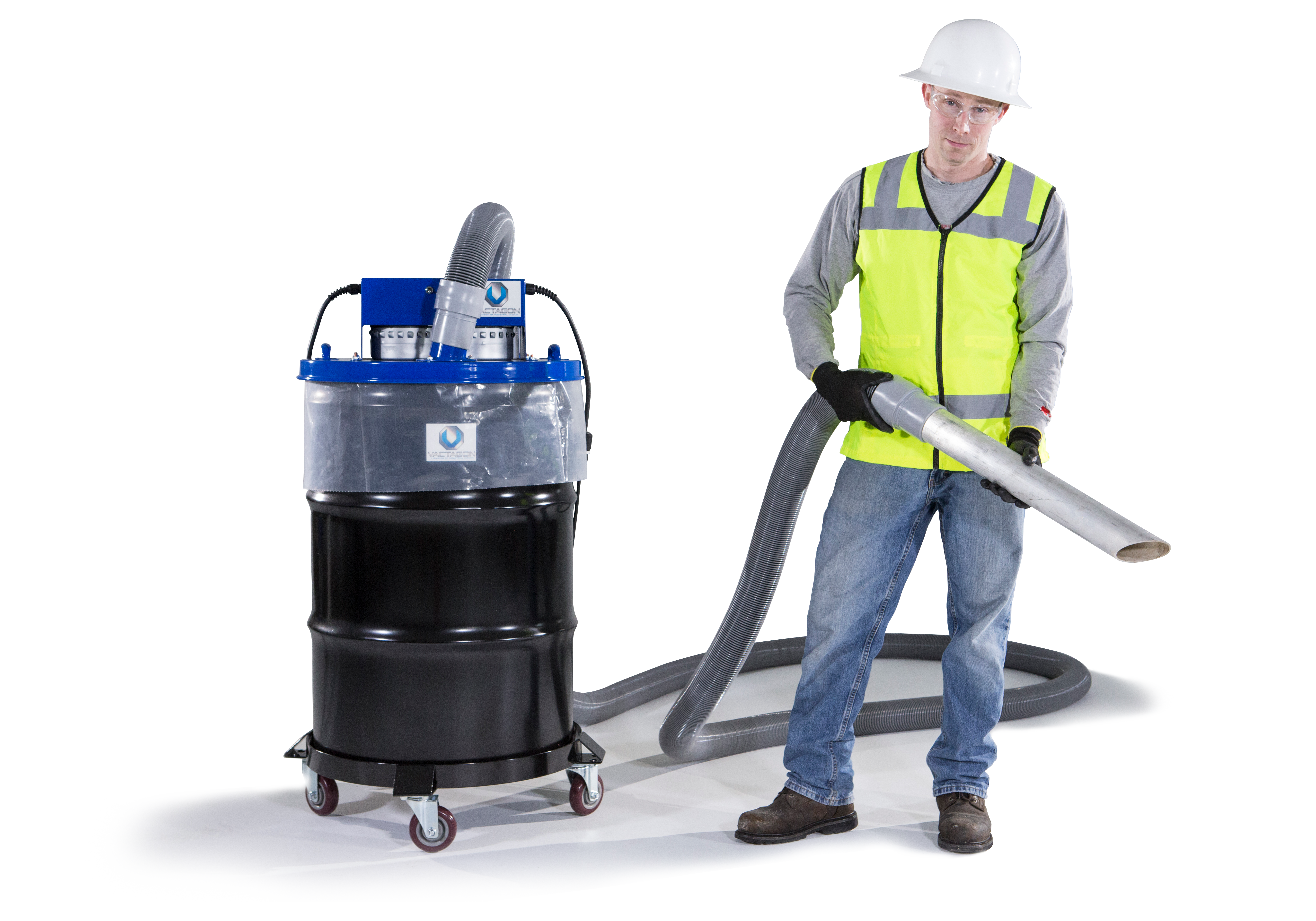 Man wearing hard hat and holding vacuum with hose