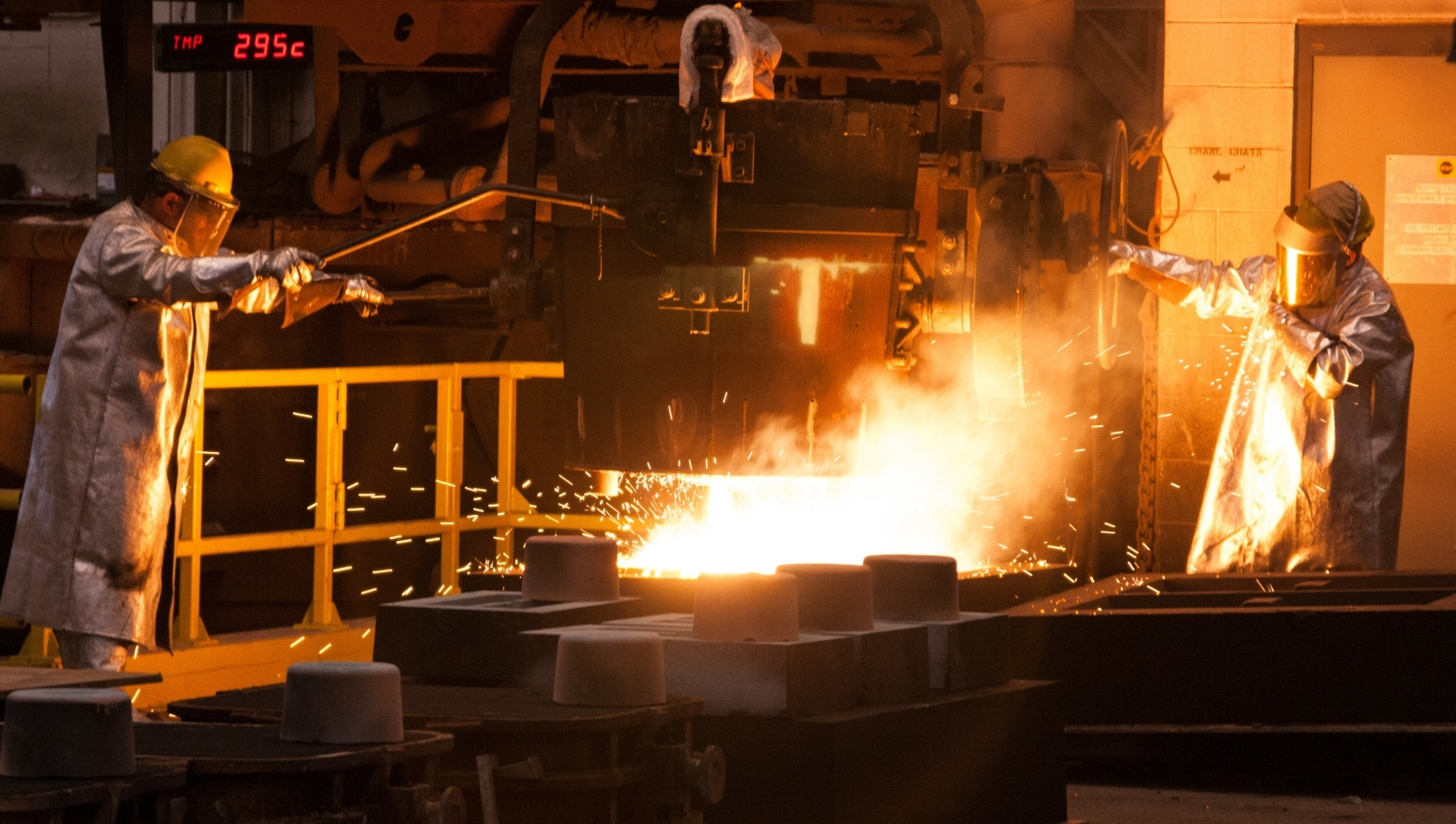 metal foundry employees working