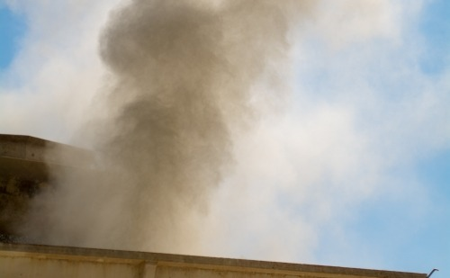 Dust Coming off a Roof in Daylight