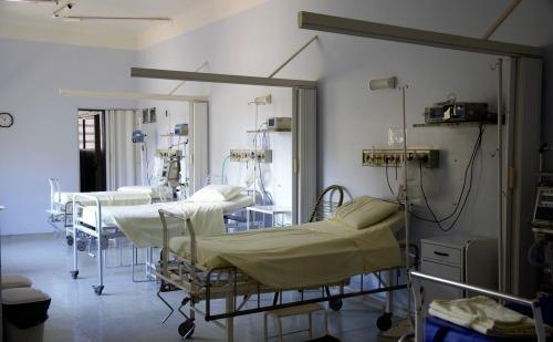 Empty hospital beds, negative pressure room