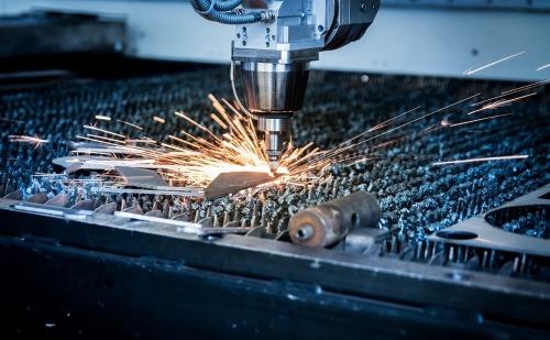 A Laser Machine Cutting into Metal