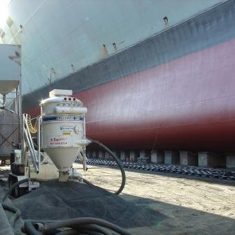 Ship Being Sandblasted in Shipyard