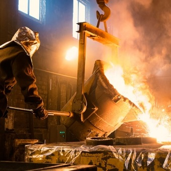 Man Pouring Liquid Metal in a Foundry