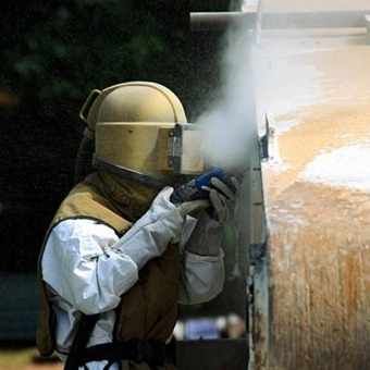 Sand Blasting Paint off of Rock Wall