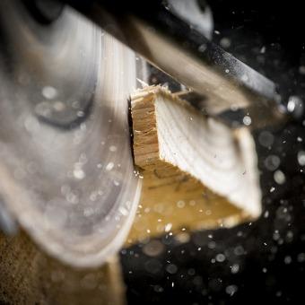 Saw Cutting Wood Piece