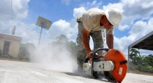 Man Using Saw to cut Cement