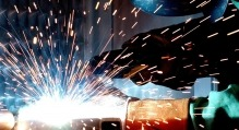 Man Welding with Sparks Flying onto his Mask