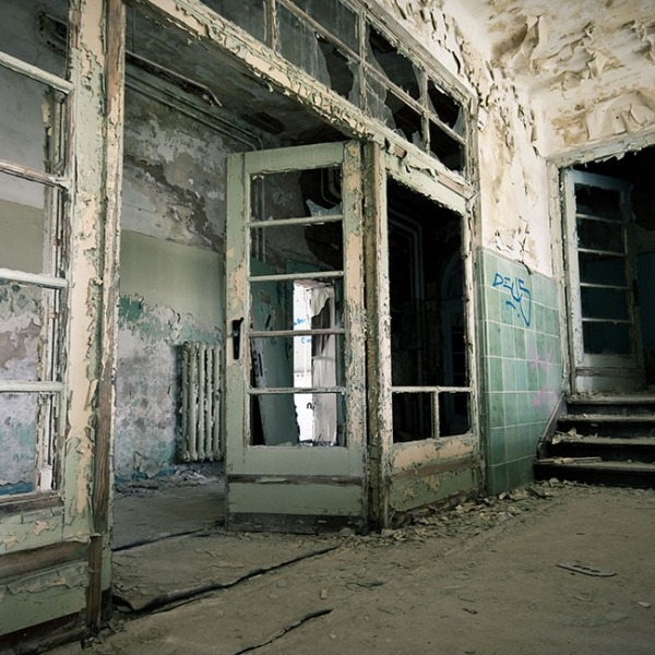 Inside of abandoned building with molding and peeling paint