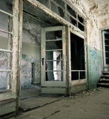 Inside of abandoned building with molding and peeling lead paint